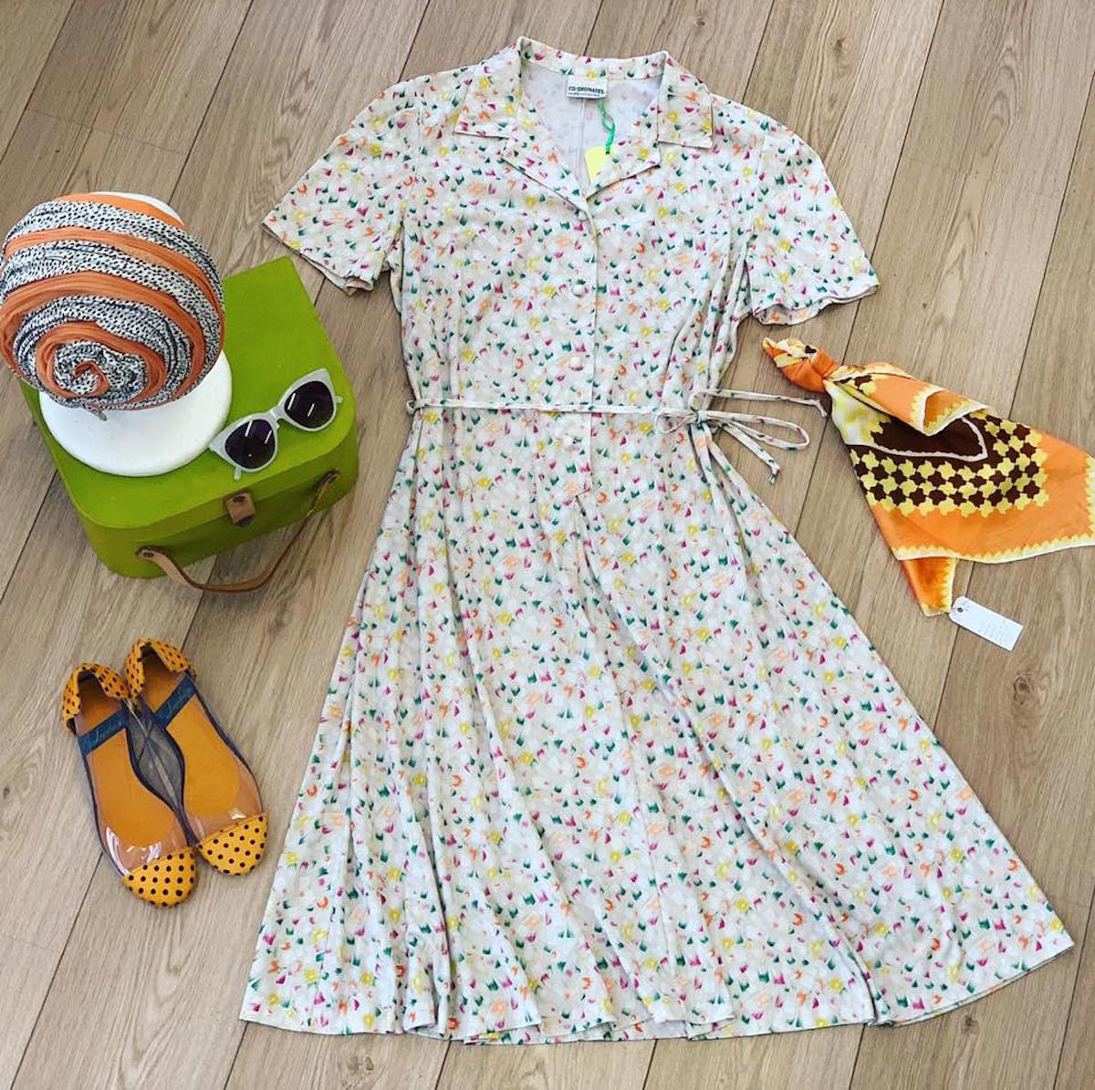 A polka dot dress with 60s sunglasses and kerchief